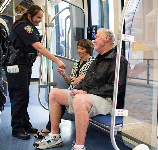 Metro Transit Police officer checking light rail fares
