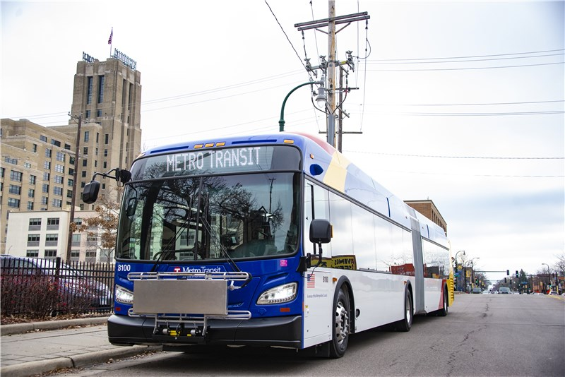 An image of a METRO BRT bus in front of the Midtown Exchange building