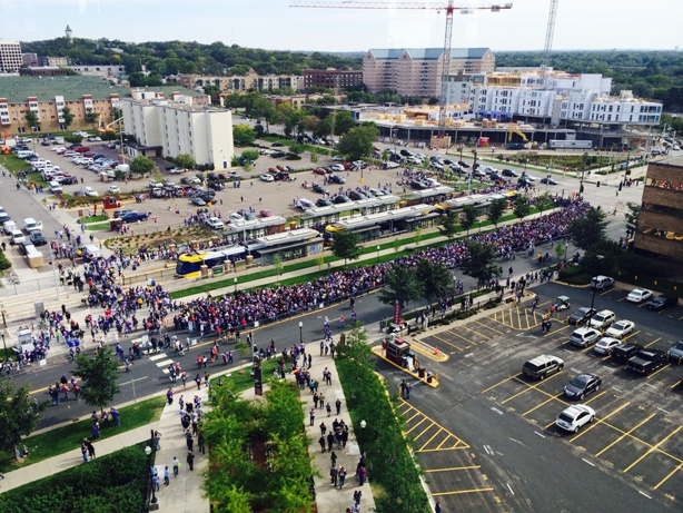 Vikings fans board the METRO Green Line at Stadium Village Station.