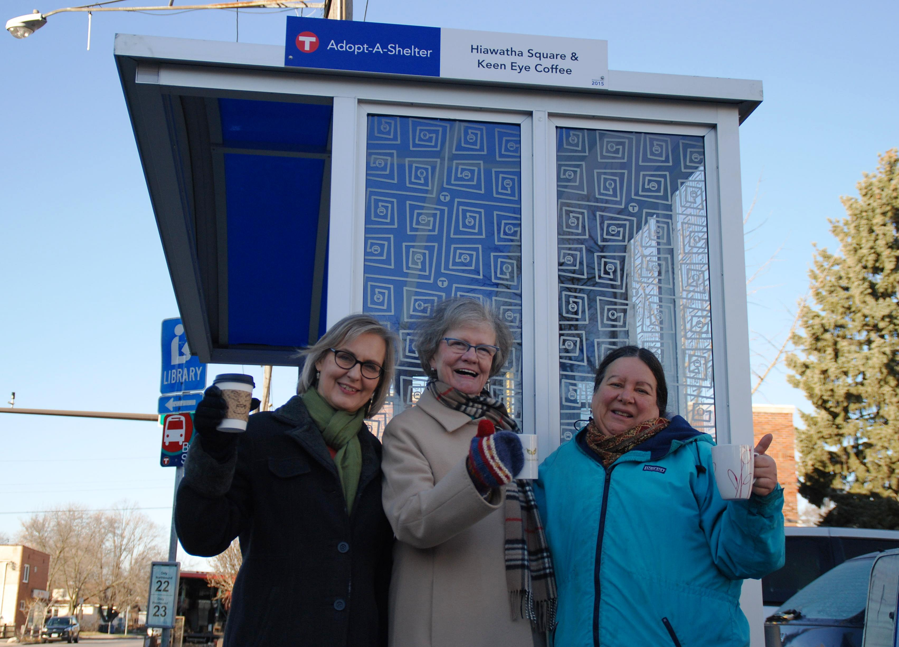 Ann Erickson, owner of Keen Eye Coffee, Doris Overby, a neighborhood block leader, and Francy Scurato, also a neighborhood block leader, with the shelter they adopted at the corner of East 38th Street and South 28th Avenue.