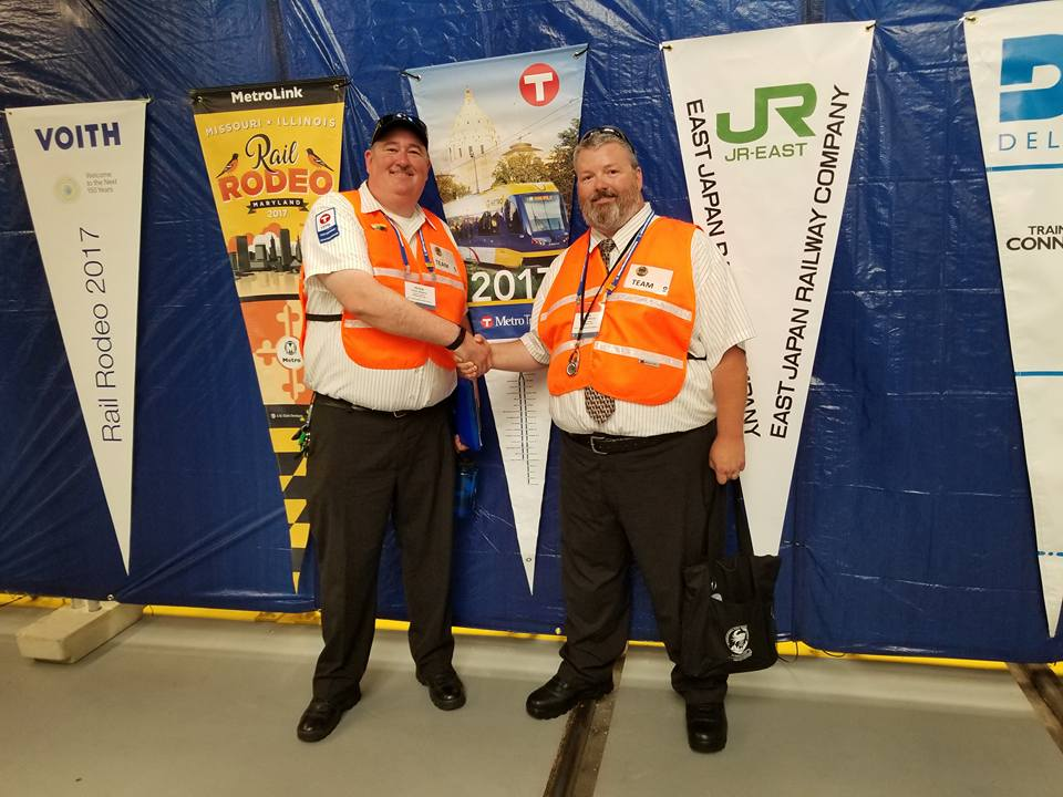 Train operators Peter Mooers, left, and Bill Morris, right, took fourth place in the American Public Transit Association's International Rail Rodeo held earlier this month in Baltimore, Md.
