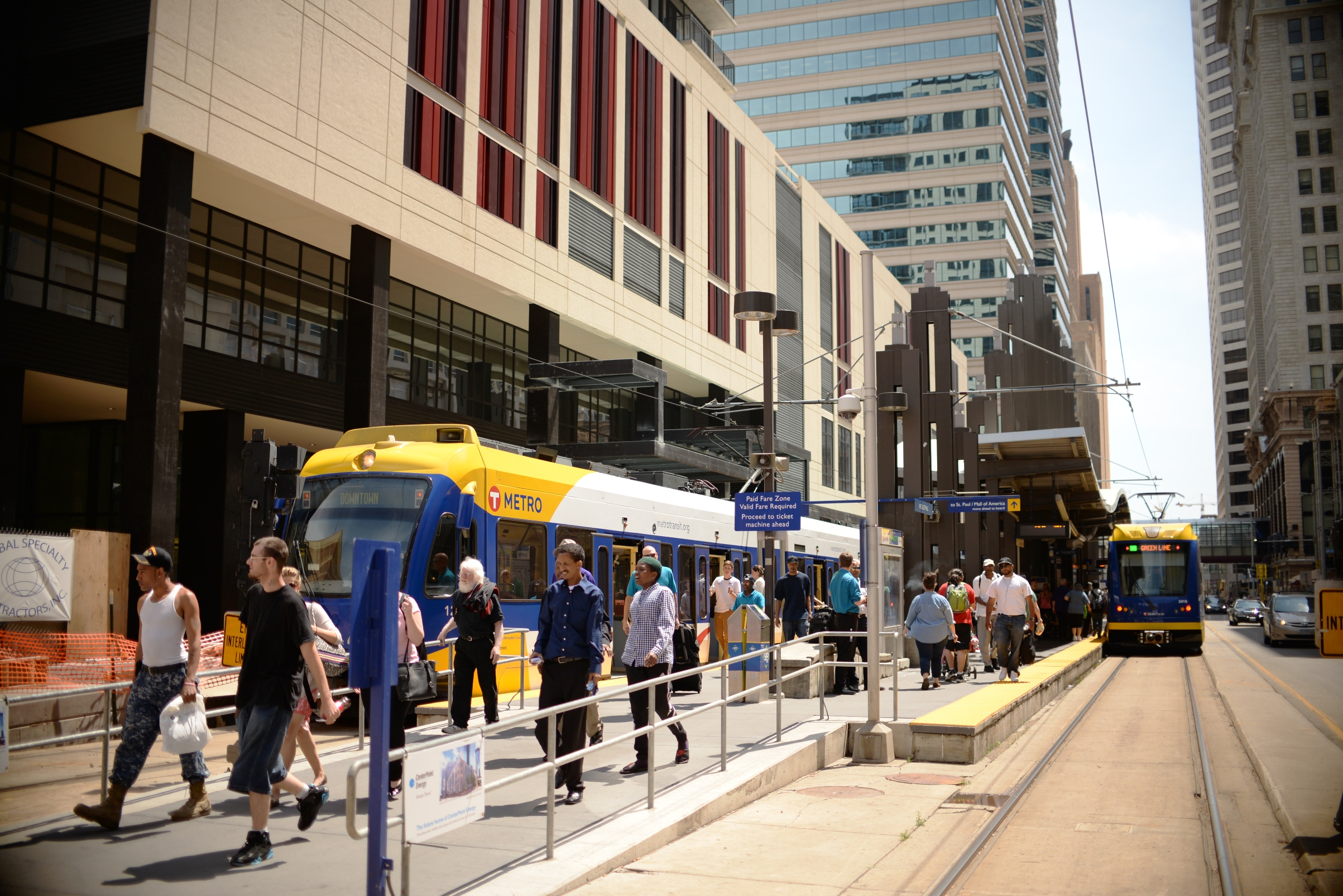 Customers exit a light-rail train at Nicollet Mall Station in downtown Minneapolis.