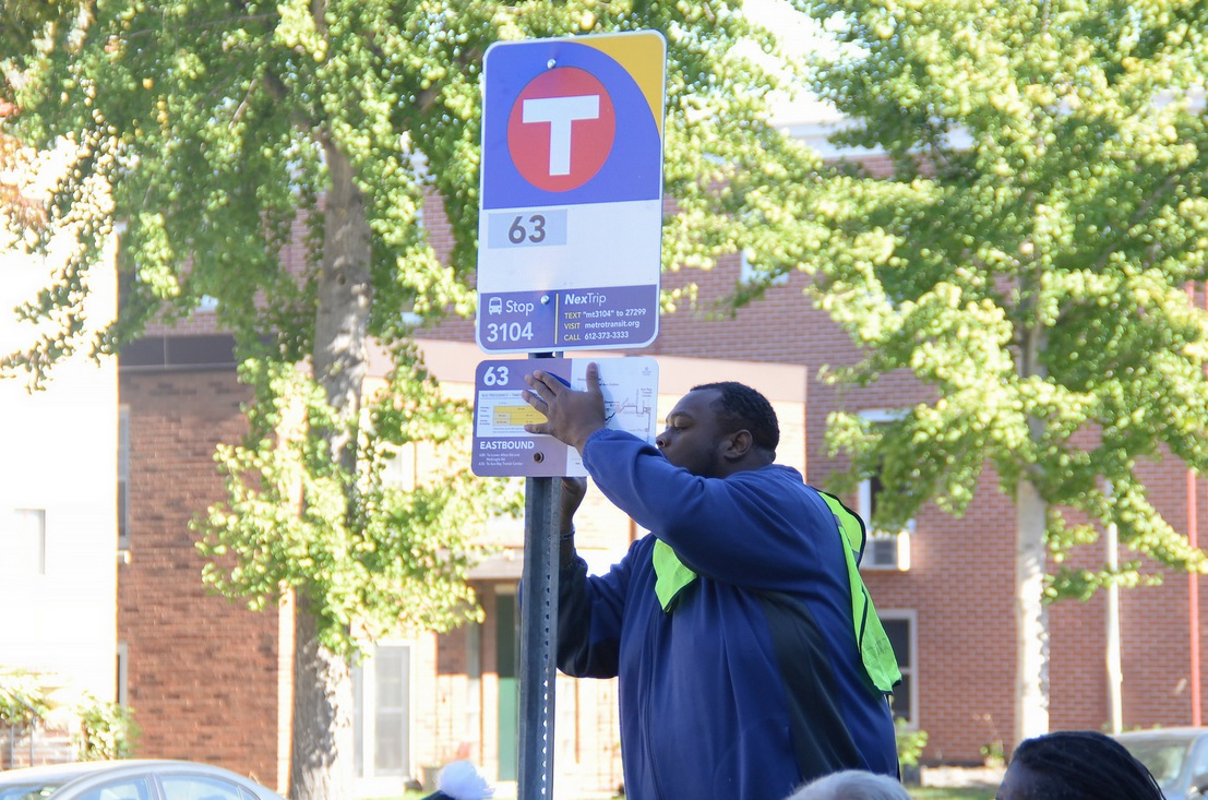A new Metro Transit bus stop sign is installed on Grand Avenue in St. Paul on Tuesday, Oct. 13, 2015.
