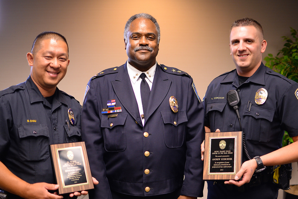 Officer Sithyvon Chau, Police Chief John Harrington and Officer Andrew Schroeder at the Metro Transit Police Department's 2014 Awards Ceremony.