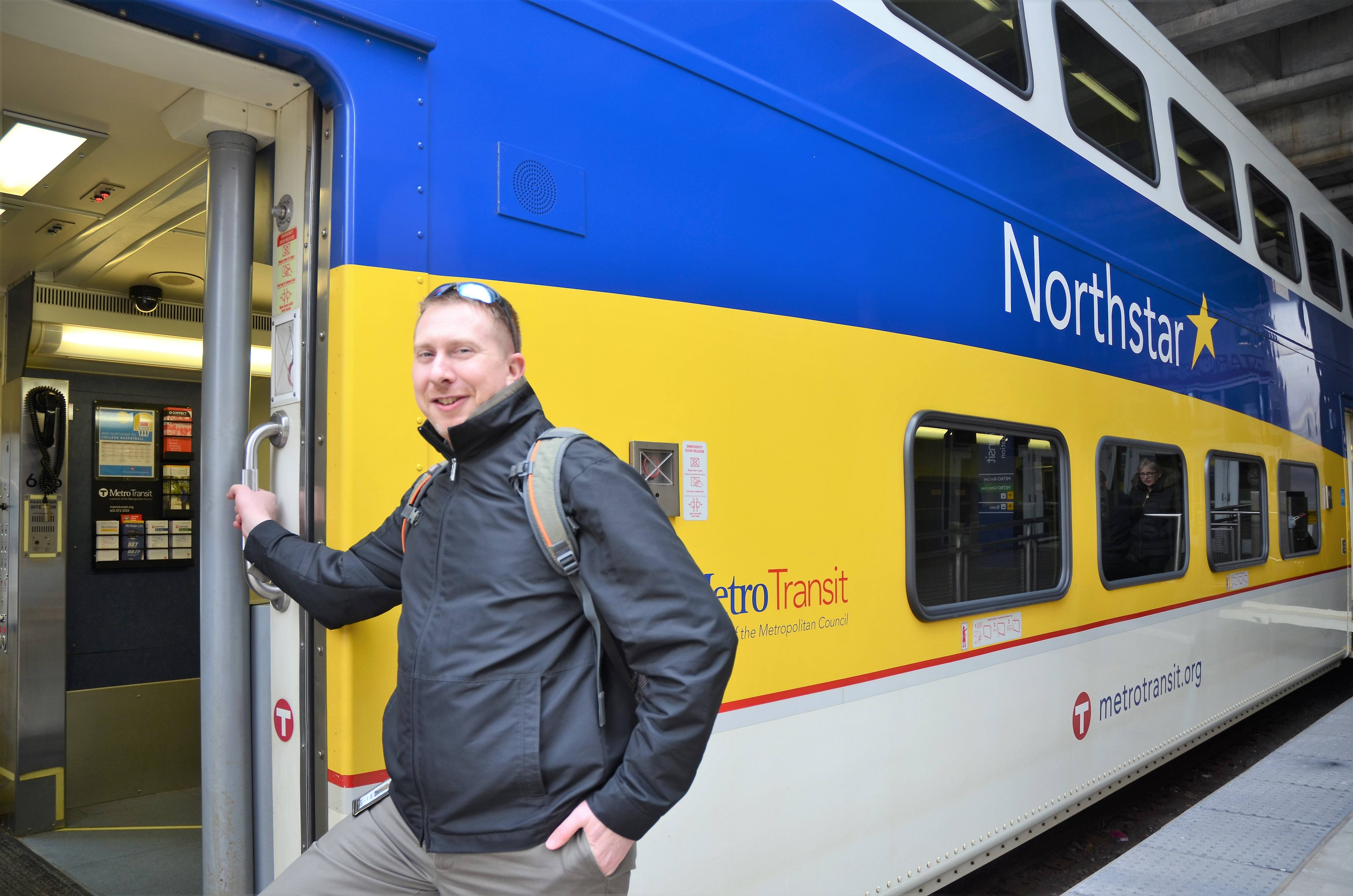 Associate Planner Clayton Watercott boards the Northstar Commuter Rail Line at Target Field Station in Minneapolis.
