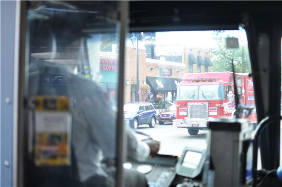 A bus driver watches as a firetruck passes by during a Metro Transit safety training course.