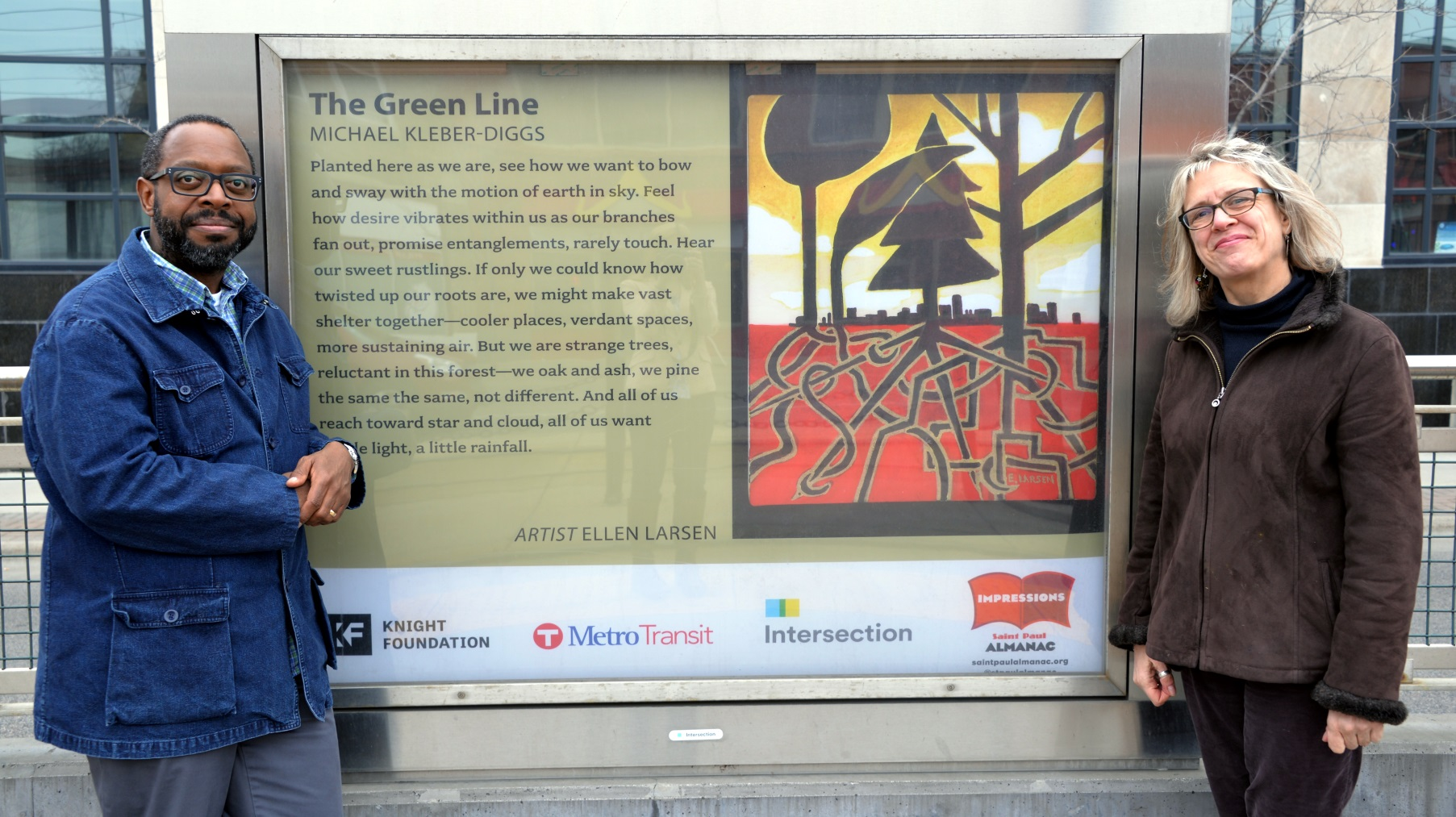 Michael Kleber-Diggs and Ellen Larsen with their poem and artwork at the Green Line's Western Avenue Station.