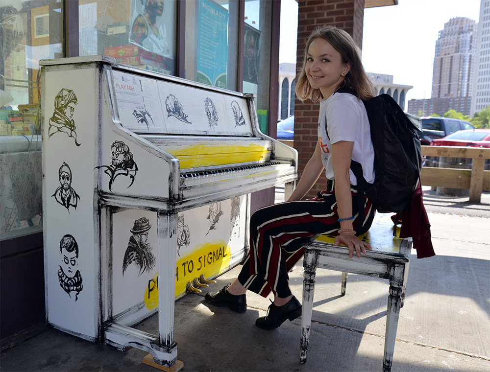 "Alexandra Norwick with her ""Voices on Transit"" piano."