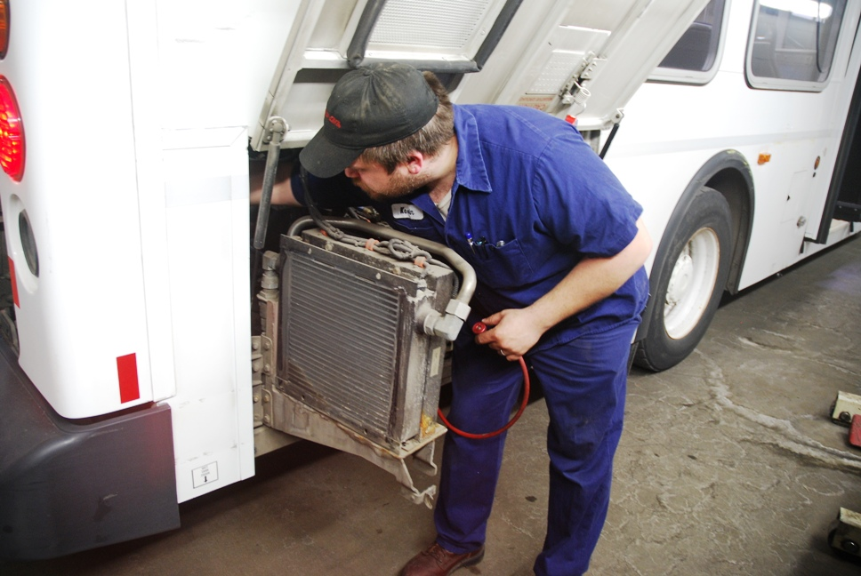 Mechanic-technician Kevin Hendrickson checks the heating and cooling system on a Metro Transit Bus.