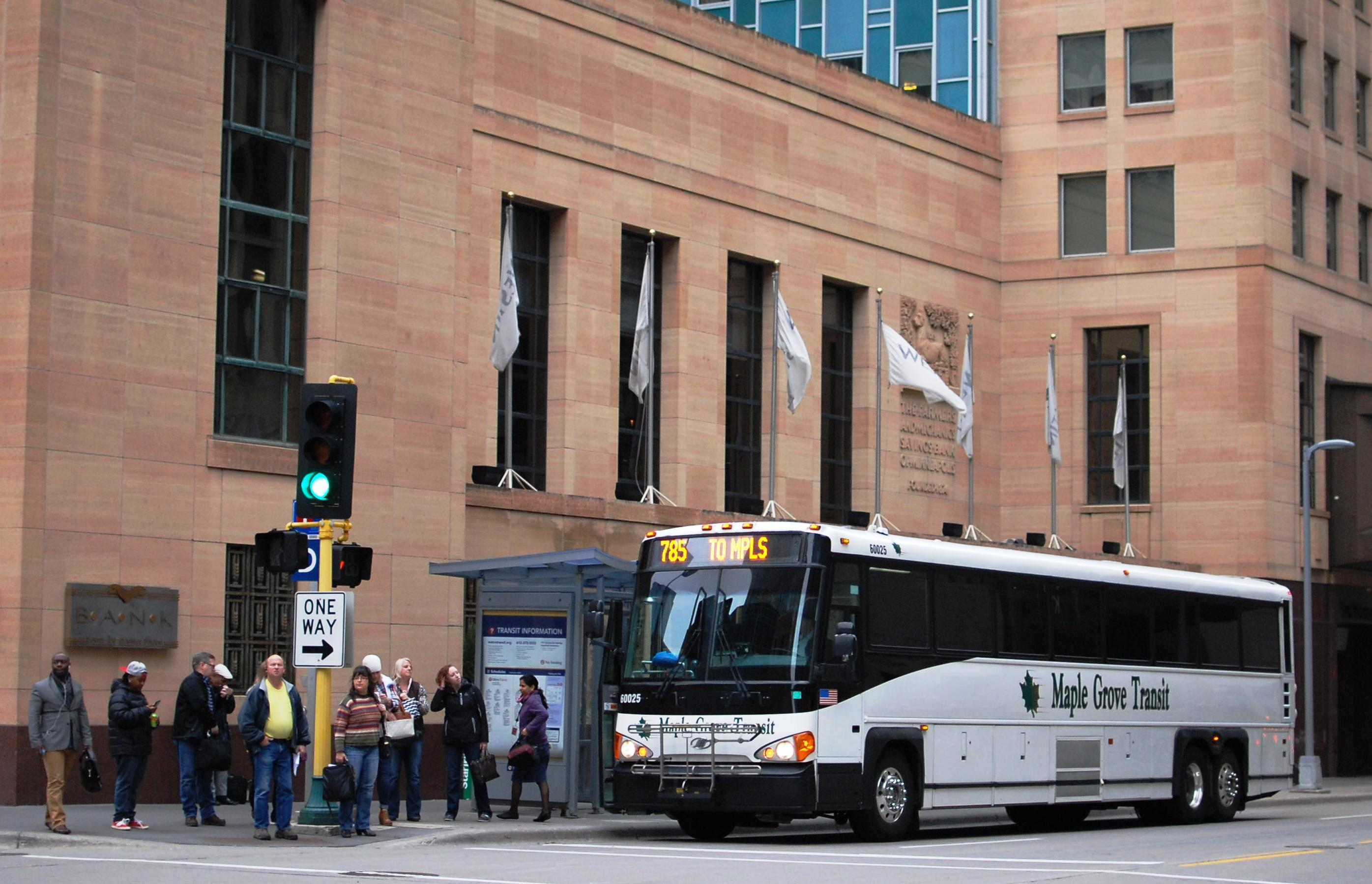 Customers exit a Maple Grove Transit bus in downtown Minneapolis.