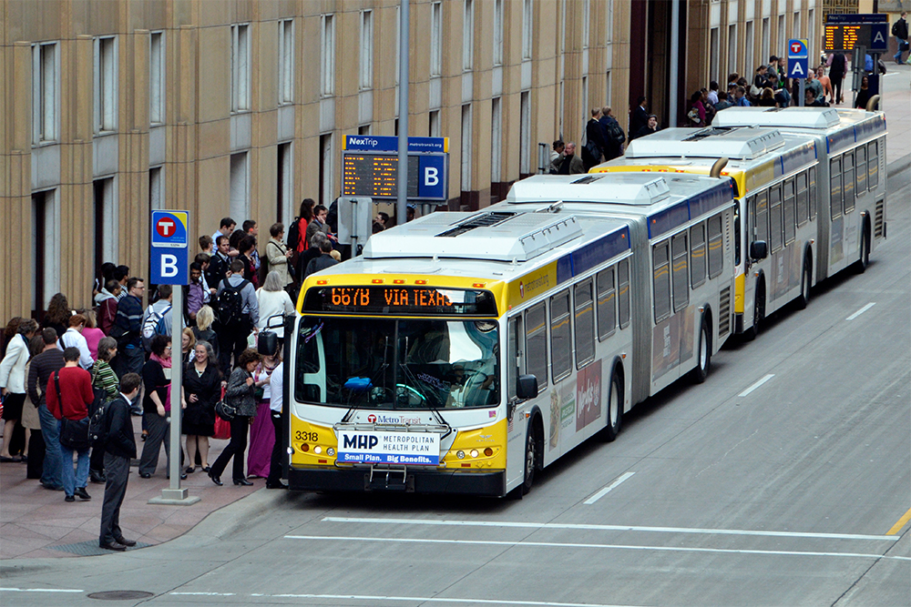 Commuters exit a Metro Transit bus in downtown Minneapolis.