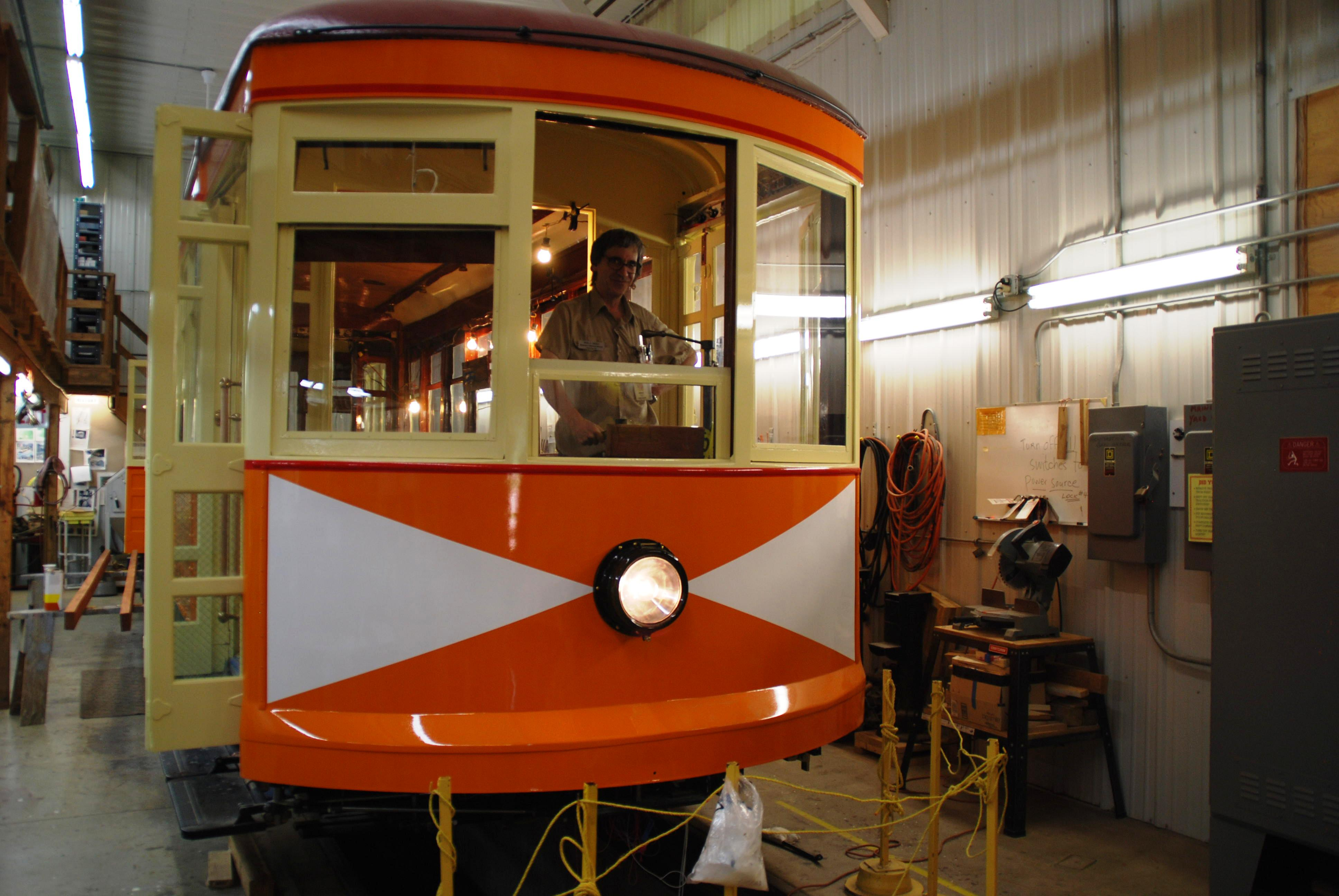 Signals Foreperson Mike Miller inside the Winona Streetcar No. 10 currently being restored in Excelsior.