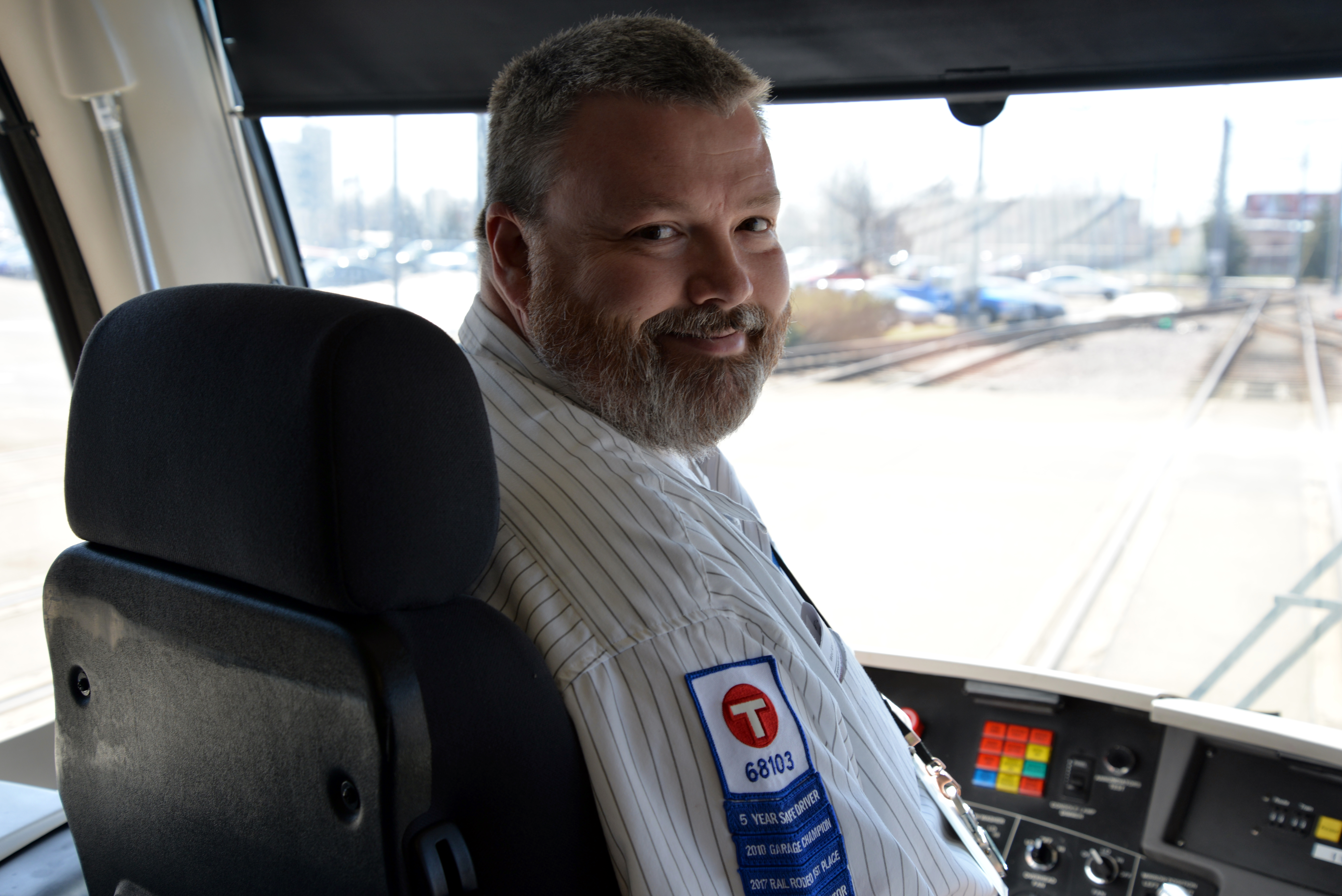 Metro Transit Train Operator Bill Morris in the cab of a light rail train.