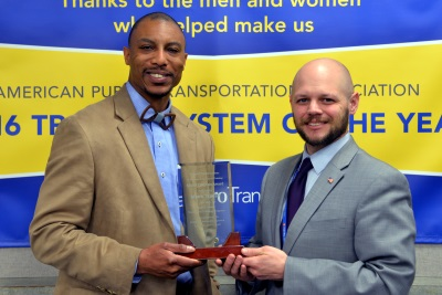 Equal Opportunity Consultant Gary Courtney, left, and Deputy Chief of Operations-Bus, Brian Funk, accepted the Model Program award this week at the National Transit Institute's Transit Trainers Workshop.