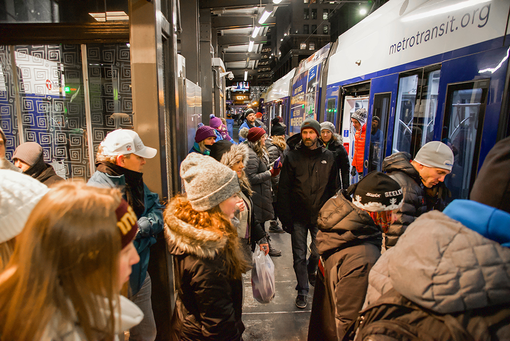 Customers board a Metro Transit light rail vehicle at the Nicollet Mall Station in 2018.