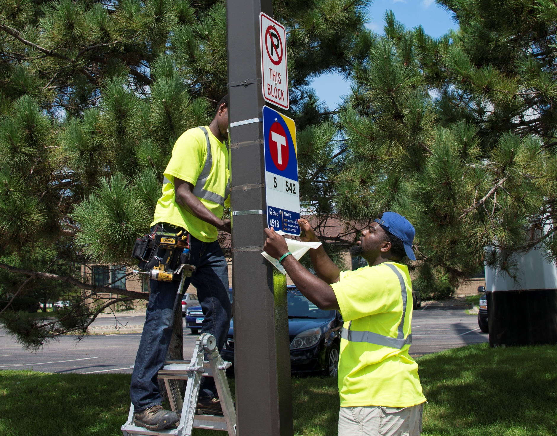 A new bus stop sign is installed on American Boulevard.