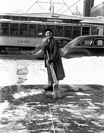 photo of man clearning snow in 1951 in St. Paul