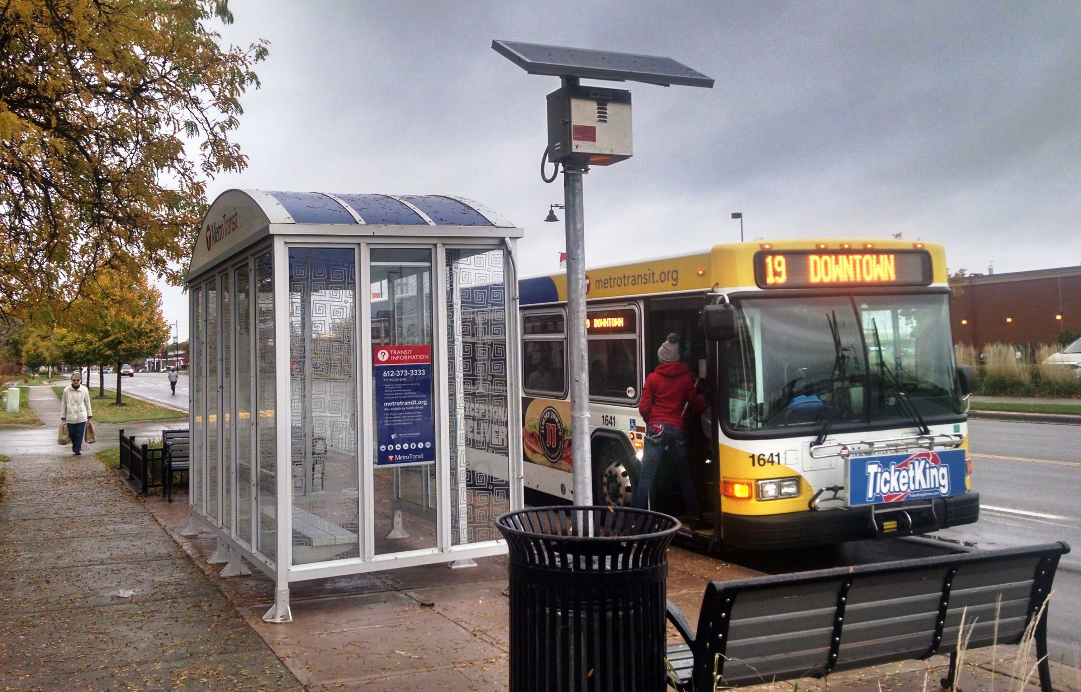 A pole-mounted solar panel is used to provide power for lighting at this Metro Transit bus shelter.