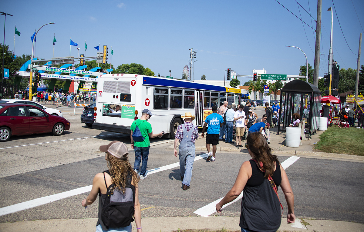 Minnesota State Fair visitors arrive at the fairgrounds on a Route 84 bus during the 2018 State Fair.