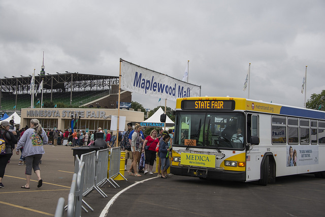 Customers exit Metro Transit express buses at the Minnesota State Fair.