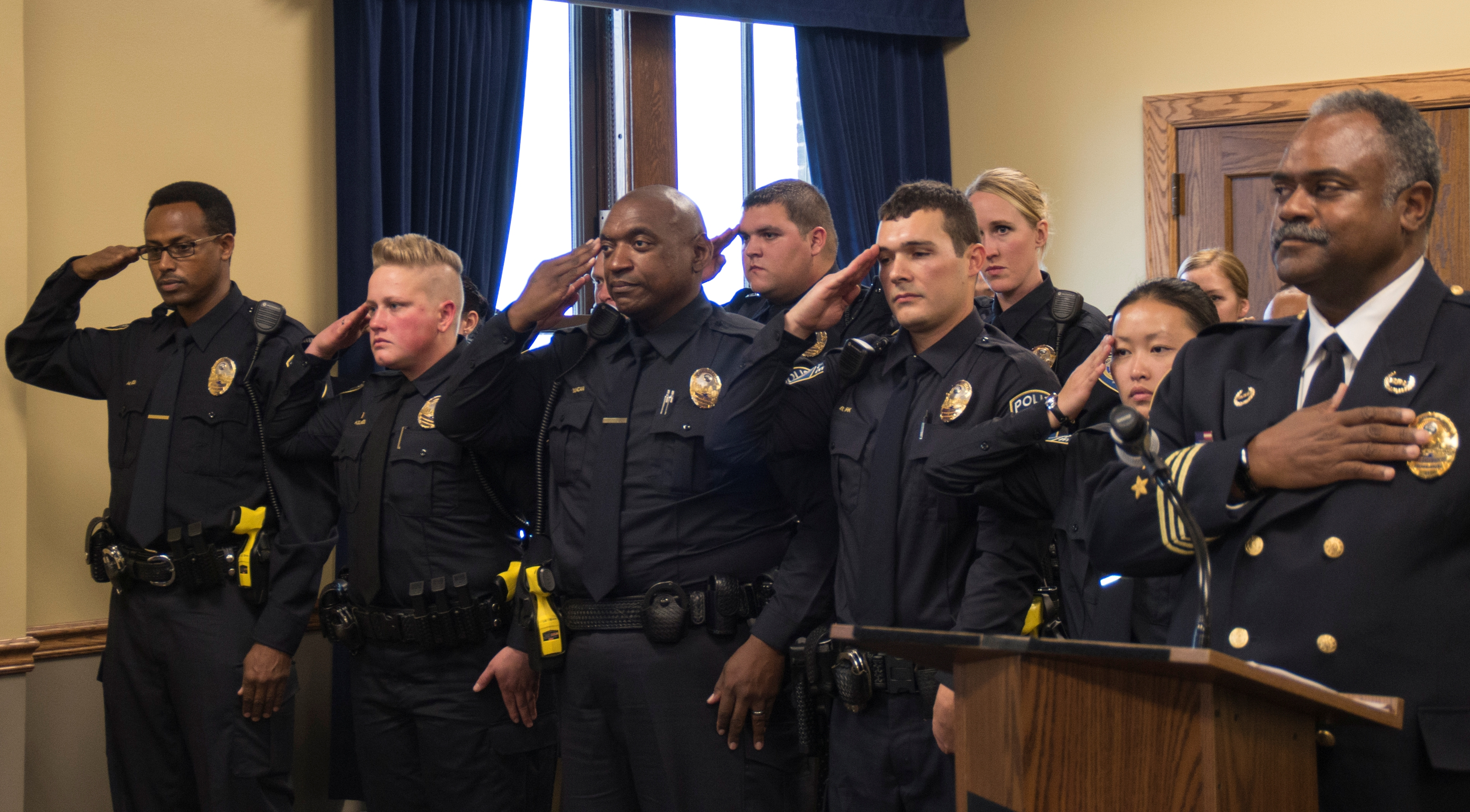 Metro Transit Police Chief John Harrington and officers at a swearing-in ceremony at the Union Depot on Thursday, Nov. 5, 2015.