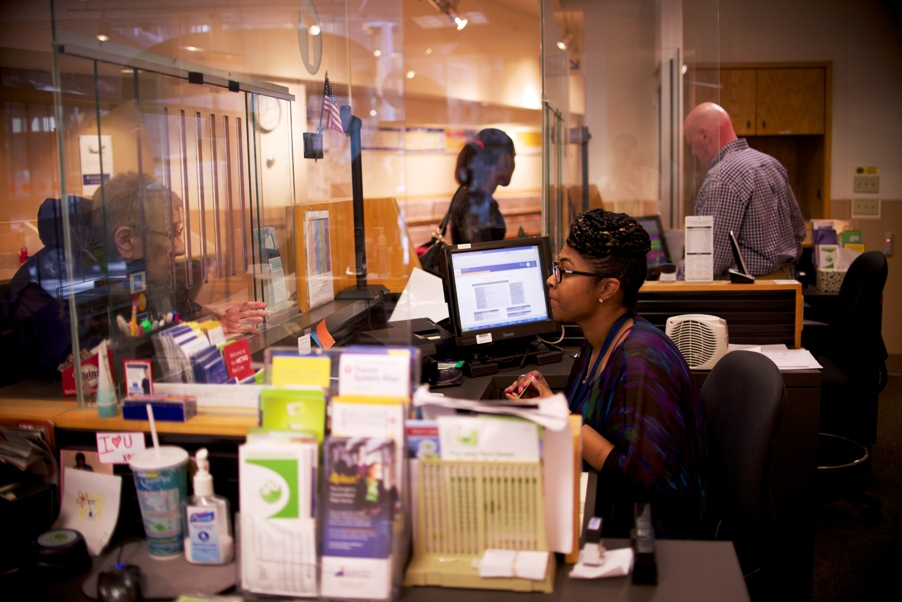 Lalita Williams (foreground) and Tim Johnson assist customers at the Metro Transit store on Marquette Avenue in Minneapolis.