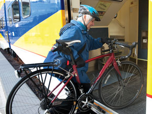 Bicyclist boarding train