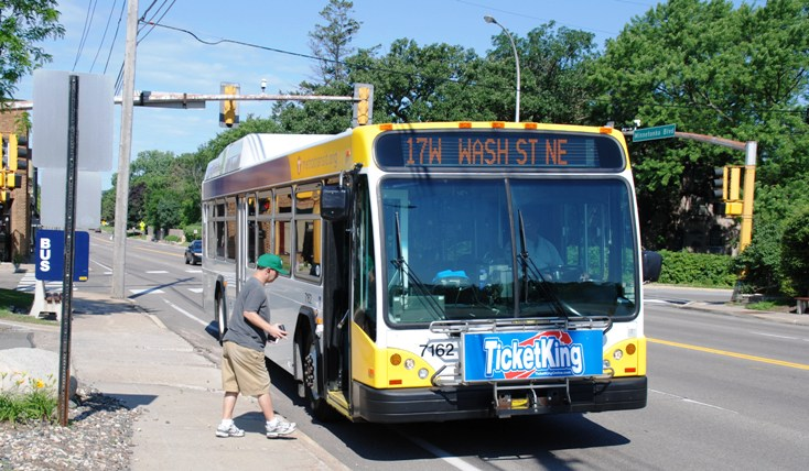 A passenger boards a Route 17 bus in St. Louis Park.