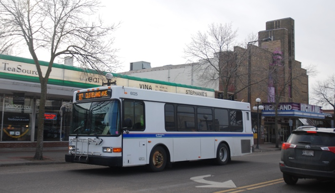 A Route 87 bus travels through St. Paul's Highland Village neighorhood on Cleveland Avenue.