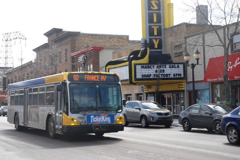 A Route 6 bus travels on 4th Street SE in Dinkytown.