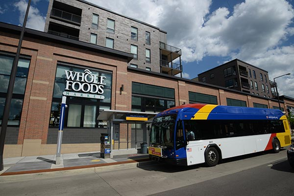 A Line bus at station near Whole Foods